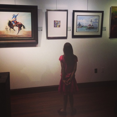 Girl looking at my painting